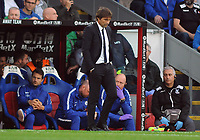 Football - 2017 / 2018 Premier League - Crystal Palace vs. Chelsea<br /> <br /> Chelsea Manager, Antonio Conte hangs his head as his team slip to defeat at Selhurst Park.<br /> <br /> COLORSPORT/ANDREW COWIE