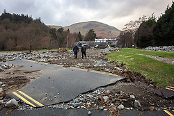 © Licensed to London News Pictures. 18/03/2016. Cumbria UK. File picture shows the road leading to the steamer pier at Ullswater damaged by storms last December. The Department for Transport has pledged an additional £82.6m today to fund essential repairs to infrastructure in Cumbria damaged by Storms Desmond & Eva last December. Photo credit: Andrew McCaren/LNP