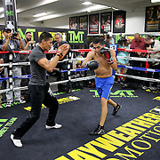 LAS VEGAS, NV - APRIL 14: Leo Santa Cruz (R) works out at the Mayweather Boxing Club on April 14, 2015 in Las Vegas, Nevada. Santa Cruz will fight on the undercard of the Floyd Mayweather Jr. vs Manny Pacquiao bout on May 2, 2015 in Las Vegas.  (Photo by Alex Menendez/Getty Images) *** Local Caption *** Leo Santa Cruz