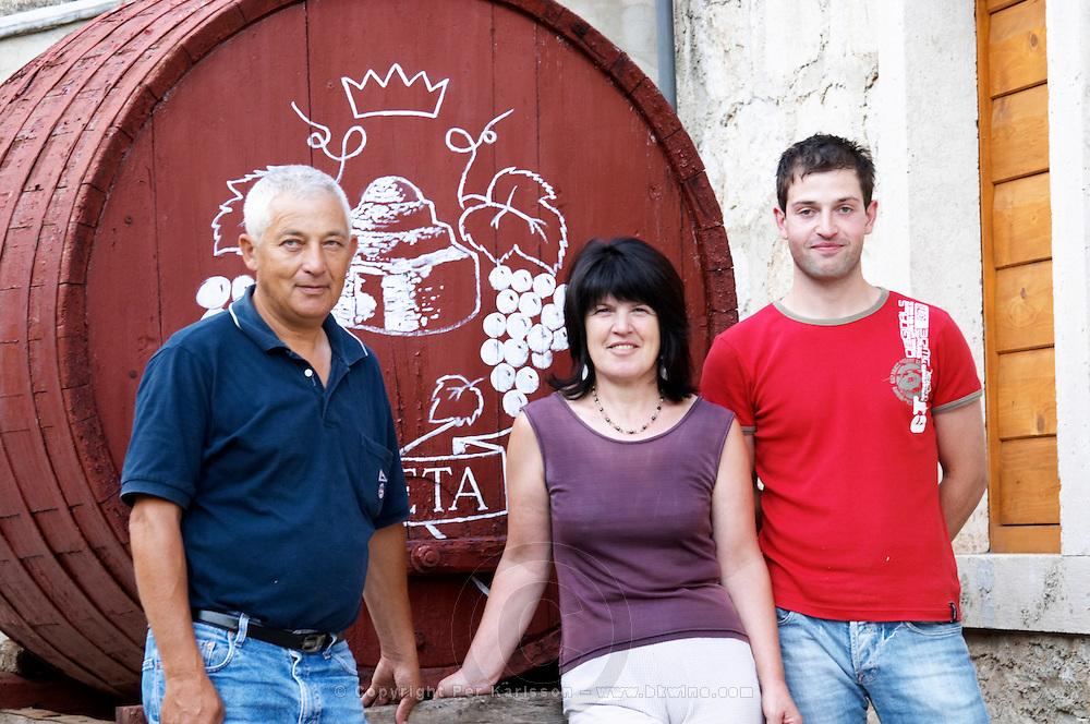 Frano and Paval Banicevic, father and son and Frano's wife, two generations winemakers, in front of the winery. Toreta Vinarija Winery in Smokvica village on Korcula island. Vinarija Toreta Winery, Smokvica town. Peljesac peninsula. Dalmatian Coast, Croatia, Europe.