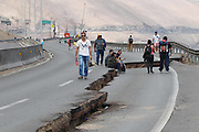 April 2, 2014 - Iquique, Chile - <br /> <br /> 8.2 Earthquake Hits Chile's Northern Coast<br /> <br /> People walk on a damaged highway after an earthquake hit Iquique of Tarapaca Region, north of Chile. An 8.2-magnitude earthquake hit off the northern coast of Chile Tuesday, leaving 6 people dead while thousands of people have been evacuated due to a tsunami alert. <br /> ©Exclusivepix