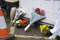 Flowers left outside Dereham Road mosque, one week after the shootings in Christchurch, New Zealand, 22 March 2019 UK