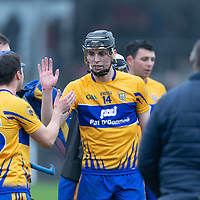 Clare's Jack Browne congratulates the goal scorer Colin Guilfoyle after the final whistle