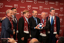 Oct 21, 2019; Sacramento, CA, USA; Sacramento Republic FC ownership Ken Nagle, from left, Matt Alvarez and Ron Burkle pose with MLS Commissioner Don Garber, Sacramento Mayor Darrell Steinberg and Calif. Gov. Gavin Newsom during the announcement that Major League Soccer has award an expansion team to Sacramento, at The Bank. Mandatory Credit: D. Ross Cameron-USA TODAY Sports
