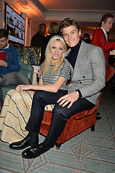 PIXIE LOTT and OLIVER CHESHIRE at the Fortnum & Mason and Quintessentially Foundation Fayre of St.James's in association with The Crown Estate held at St.James's Church, Piccadilly followed but a reception at Fortnum & Mason, Piccadilly,London on 5th December 2013.