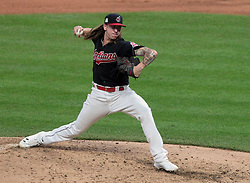 October 6, 2017 - Cleveland, OH, USA - Cleveland Indians relief pitcher Mike Clevinger works against the New York Yankees in the fourth inning during Game 2 of the American League Division Series, Friday, Oct. 6, 2017, at Progressive Field in Cleveland. (Credit Image: © Mike Cardew/TNS via ZUMA Wire)