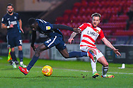 Elvis Bwomono of Southend United (2) and James Coppinger of Doncaster Rovers (26) clash for the ball during the EFL Sky Bet League 1 match between Doncaster Rovers and Southend United at the Keepmoat Stadium, Doncaster, England on 12 February 2019.