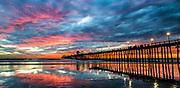 Vivid Sunset Reflections At Oceanside Pier