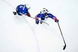 Great Britain's Saffron Allen (right) and Slovenia's Arwen Nylaander battle for the puck during the Beijing 2022 Olympics Women's Pre-Qualification Round Two Group F match at the Motorpoint Arena, Nottingham.