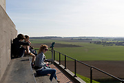 Visitors on the summit of the Lion's Mound overlook a landscape of fields and farming land and looking in the direction of Napoleon's massed French lines during the Battle of Waterloo, on 25th March 2017, at Waterloo, Belgium. Waterloo was fought  on 18 June 1815 between a French army under Napoleon Bonaparte,  defeated by two of the armies of the Seventh Coalition: an Anglo-led Allied army under the command of the Duke of Wellington, and a Prussian army under the command of Gebhard Leberecht von Blücher, resulting in 41,000 casualties.