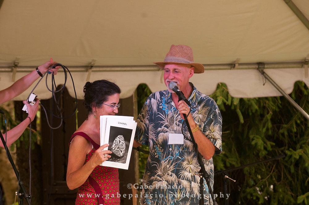 Maggi Landau, producer, with granddaughter at the American Roots Music Festival at Caramoor in Katonah New York.photo by Gabe Palacio