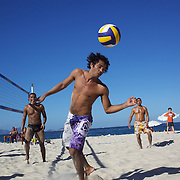 Locals play foot  volley, a hybrid game combining beach volley ball and football at Copacabana beach, Rio de Janeiro,  Brazil. 4th July 2010. Photo Tim Clayton.