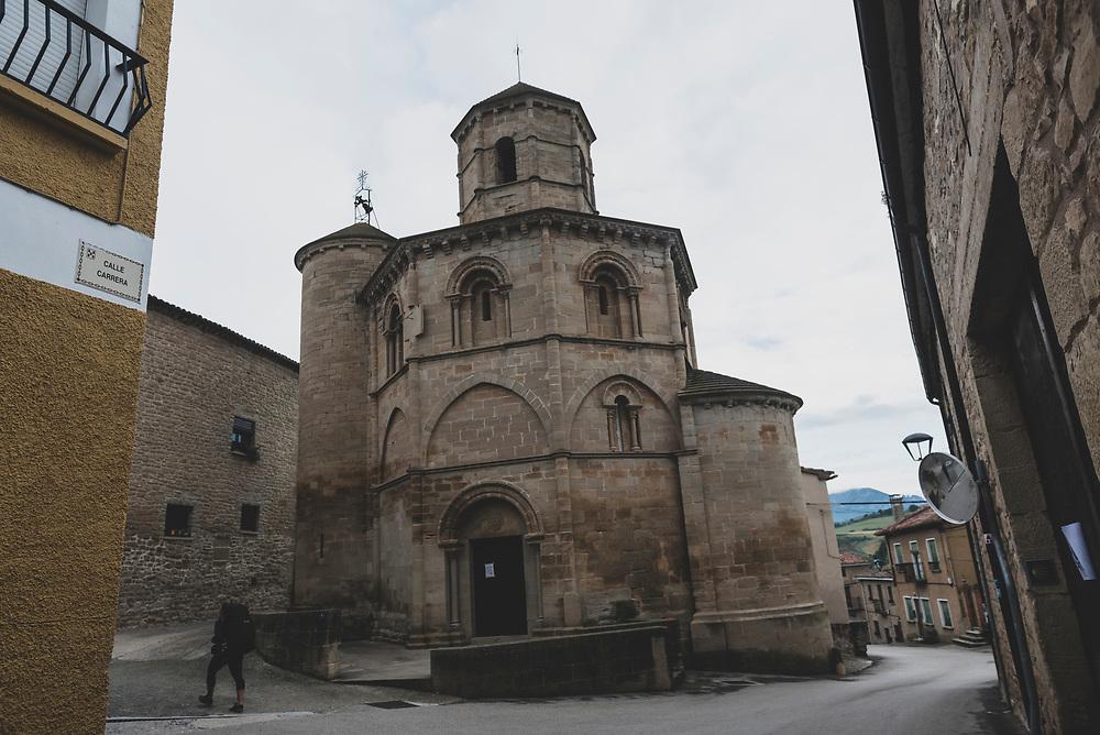 A pilgrim walking the Camino de Santiago passes by the 12th century octagonal Iglesia de Santo Sepulcro in Torres del Rio, Spain. (June 6, 2018)<br /> <br /> DAY 10: SANSOL TO LOGRONO -- 21 KM