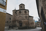 A pilgrim walking the Camino de Santiago passes by the 12th century octagonal Iglesia de Santo Sepulcro in Torres del Rio, Spain. (June 6, 2018)<br />