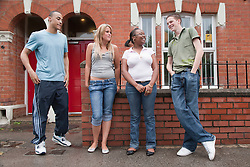 Group of teenagers in the street.