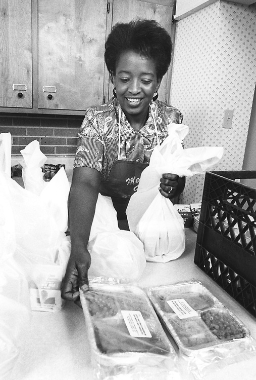 ©1989 Meals on Wheels volunteer Jessica Fowler prepares a delivery.