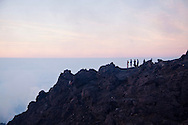 Climbers atop Mount Merapi in Central Java, Indonesia, Southeast Asia