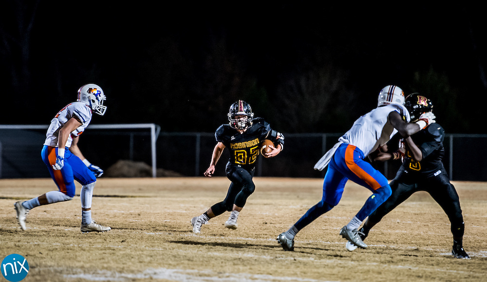 Jay M. Robinson's Dawson Williams (22) carries the ball against Marvin Ridge Friday night during the second round of the NCHSAA 3AA playoffs. Marvin Ridge won the game 48-28 and will play Hickory Ridge next week.