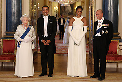 Queen Elizabeth II and the Duke of Edinburgh pose with U.S. President Barack Obama and First Lady Michelle Obama in the Music Room of Buckingham Palace ahead of a State Banquet, as part of the Presidents three-day state visit to the UK.