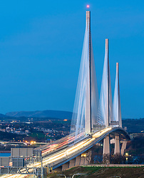 View at night of new Queensferry Crossing bridge spanning the Firth of Forth between West Lothian and Fife in Scotland, United Kingdom.