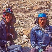 Thakali traders rest beside the trail in the Kali Gandaki Valley, Nepal.