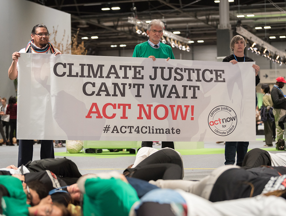 6 December 2019, Madrid, Spain: Faith-based actors led by ACT Alliance, the Lutheran World Federation, and the World Council of Churches 'sound the alarm for climate justice' at COP25, through a protest where a giant alarm clock went off, followed by testimonies of people already affected by climate change, and the chant, 'What do we want? Climate justice! When do we want it? Now! Where do we want it? Everywhere!' Here, Lutheran World Federation vice president for Latin America Nestor Friedrich (centre).