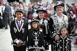 © Licensed to London News Pictures. 27/09/2015. London, UK. A family of Pearly Princes, Princesses and a Queen gather in Guildhall Square for a Harvest Festival celebration. Photo credit: Peter Macdiarmid/LNP