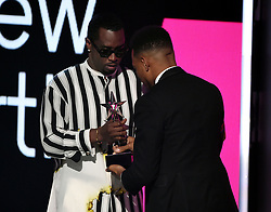 LOS ANGELES - JUNE 25: Chance The Rapper (R) accepts the award for Best New Artist from Sean 'Diddy' Combs onstage at the 2017 BET Awards at the Microsoft Theater on June 25, 2017 in Los Angeles, California. (Photo by Frank Micelotta/PictureGroup) *** Please Use Credit from Credit Field ***