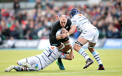 Saracens' Schalk Burger (centre) is tackled by Cardiff Blues' Olly Robinson during the Heineken European Champions Cup, pool three match at Allianz Park, London.