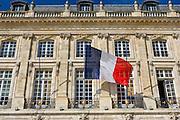 French flag at Place de la Bourse in Bordeaux, France