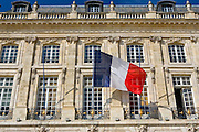 French flag at Place de la Bourse in Bordeaux, France