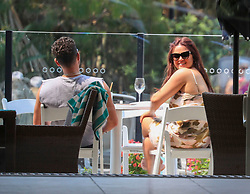 EXCLUSIVE: I'm A Celebrity UK host Adam Thomas is all ears listening to fellow Camp host Emily Atack. 22 Nov 2019 Pictured: Emily Atack Adam Thomas. Photo credit: Splash News/MEGA TheMegaAgency.com +1 888 505 6342
