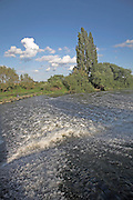 White water from the weir on the River Avon in the Vale of Evesham, Fladbury, Worcestershire, England