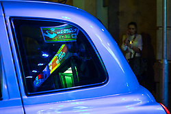 © Licensed to London News Pictures . 08/04/2017 . Manchester , UK . The reflected lights of the Funky Chicken fast food restaurant are seen the rear window of a Taxi cab on Withy Grove . Greater Manchester Police have authorised dispersal powers and say they will ban people from the city centre for 48 hours , this evening (7th April 2017) , in order to tackle alcohol and spice abuse . Photo credit : Joel Goodman/LNP