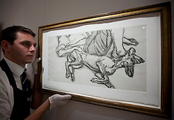 © Licensed to London News Pictures. 14/09/2012. LONDON, UK. A member of Sotheby's staff adjusts Lucian Freud's 'Pluto' (1988) est. £100,000-150,000 as the New Bond Street auction house prepares for a sale of 'Old Master, Modern and Contemporary Prints'. The auction, set to take place on the 19th of September 2012, features nearly 200 masterful works artists including Andy Warhol, Lucian Freud and Francis Bacon. Photo credit: Matt Cetti-Roberts/LNP