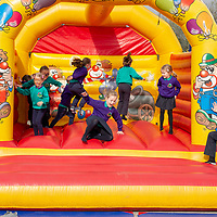 Children from Knockanean NS enjoy a  bouncy castle during their Fun Day for Jessies