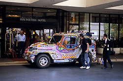 Stock photo of an art car parked in the valet at the Doubletree Hotel