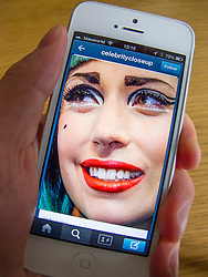 Lady Gaga photograph on Tumblr social media and photosharing app on white iPhone 5 smartphone