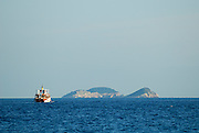 Small ferry with island in background. Dubrovnik, Croatia