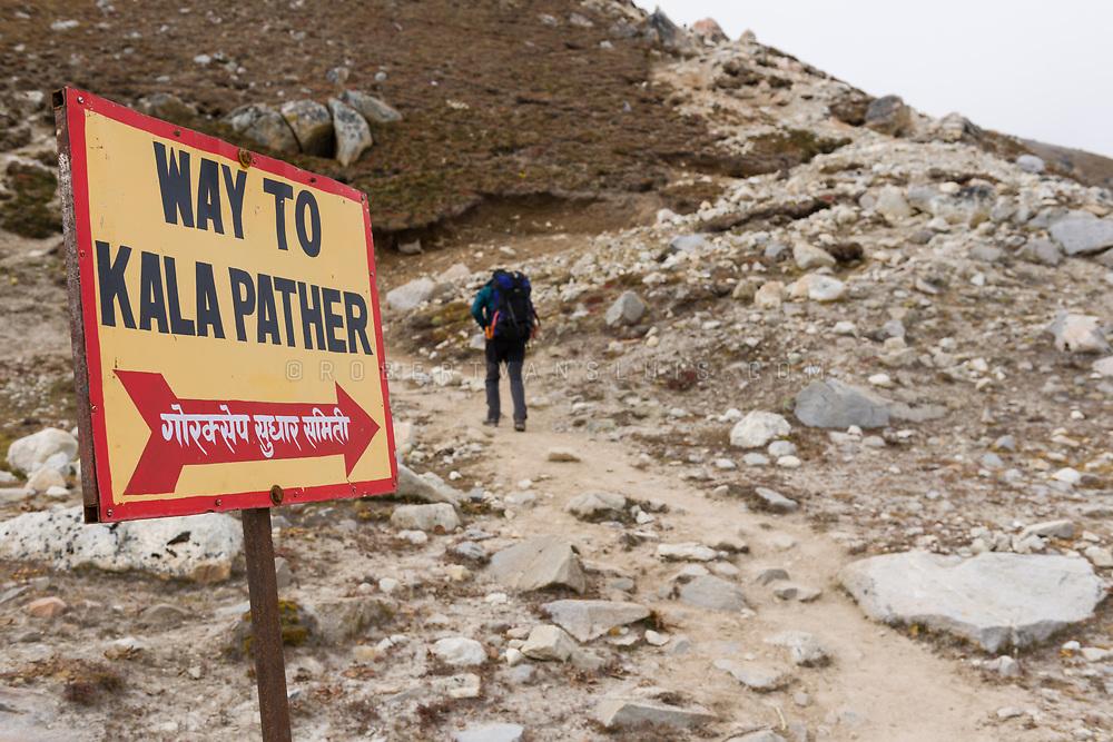 A trekker on the way to Kala Pattar, Nepal Himalaya. Photo © robertvansluis.com