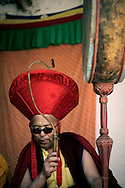 India, Ladakh. Monk during the festival ceremony in Phyang monastery.