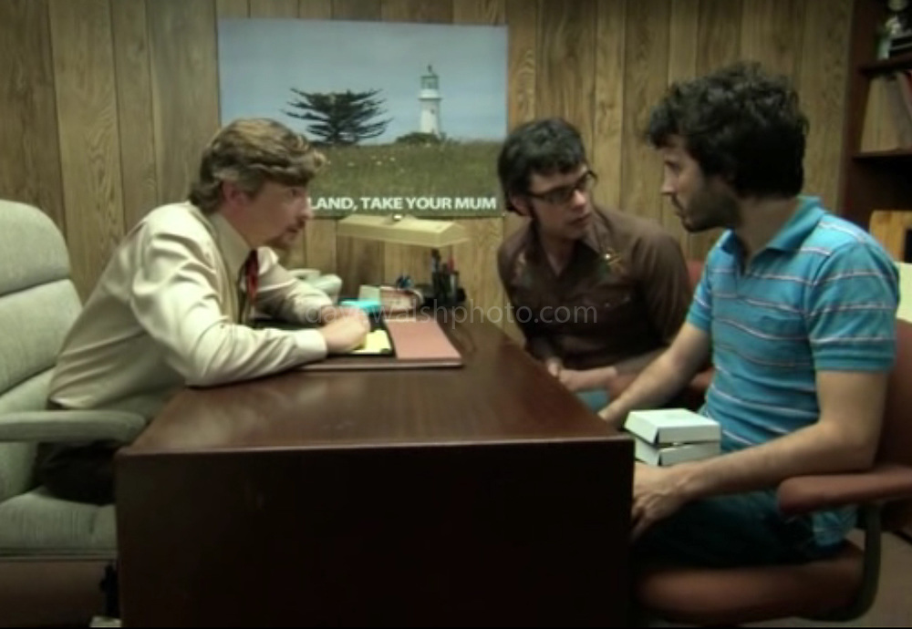 """Image of Lighthouse in Tiritiri Matangi used in HBO Series Flight of the Conchords. Photograph on wall of Murray Hewitt's office taken by Dave Walsh<br /> <br /> """"New Zealand: Take Your Mum"""", episode #17 (Series 2, episode 5) """"Unnatural Love"""""""