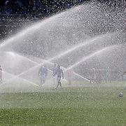 David Villa, (center), NYCFC, and players return to the field for the second half with the sprinklers still working during the New York City FC Vs New England Revolution, MSL regular season football match at Yankee Stadium, The Bronx, New York,  USA. 26th March 2016. Photo Tim Clayton