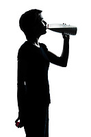 one caucasian young teenager silhouette boy or girl drinking milk  portrait in studio cut out isolated on white background