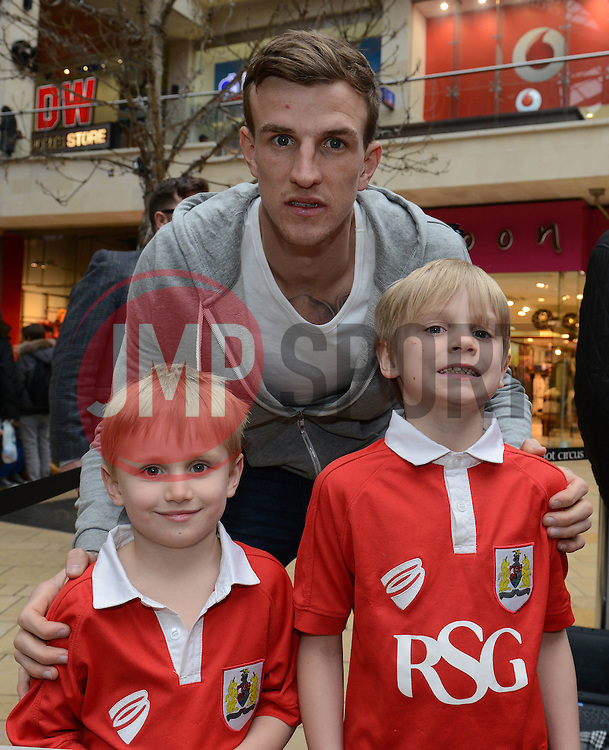 Bristol City's Aden Flint poses for a photo with Bristol City fans - Photo mandatory by-line: Dougie Allward/JMP - Mobile: 07966 386802 - 11/03/2015 - SPORT - Football - Bristol - Cabot Circus Shopping Centre - Johnstone's Paint Trophy