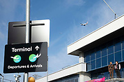 A plane flies over London City airport as Climate change protester stands on a roof  during day four of two weeks of planned demonstrations on 10th October, 2019 in London, Untited Kingdom. Extinction Rebellion is demanding that governments drastically cut carbon emissions.