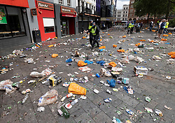 © Licensed to London News Pictures. 11/07/2021. London, UK. Police walk through a litter strewn Leicester Square after police stopped people entering in central London on the day of the final of EURO 2020 at Wembley where England will play Italy. Photo credit: Peter Macdiarmid/LNP