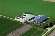 Nederland, Oostelijk Flevoland, Gemeente Dronten, 03-10-2010; Omgeving Biddinghuizen, .moderne boerderij met grote schuren omgeven door akkers.Modern farmhouse with large barns surrounded by fields..luchtfoto (toeslag), aerial photo (additional fee required).foto/photo Siebe Swart