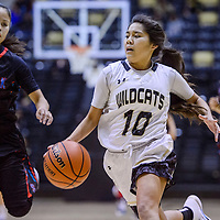 Chinle Wildcat Nahatabah Nacona (10) rushes past Shiprock Chieftain Melanie Secody (10) Friday at the Wildcat Den in Chinle.