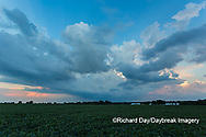 63893-03016 Passing storm clouds at sunset over agricultural field Marion Co. IL